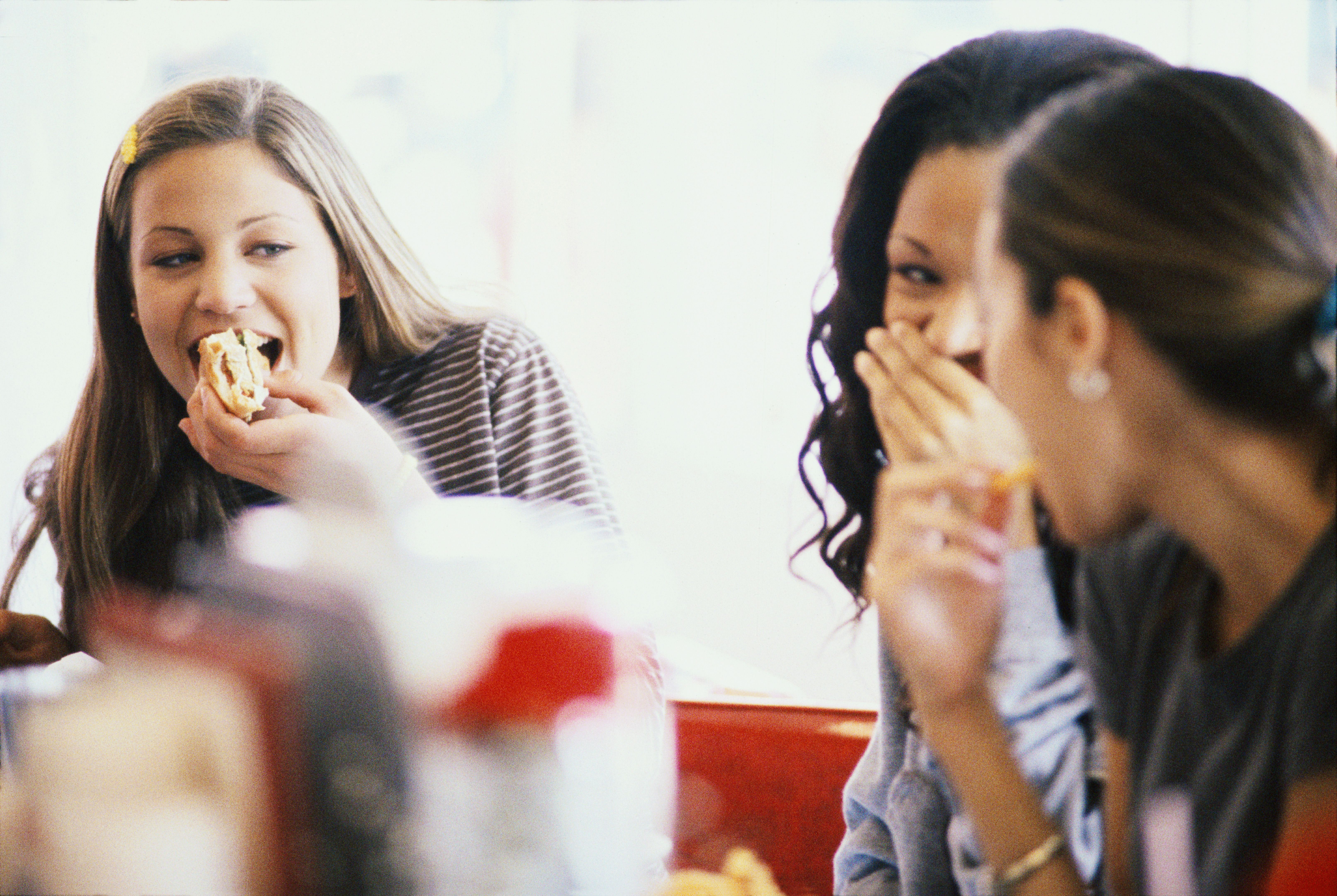 Three young women eating at a cafe